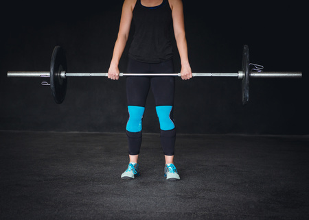 cropped out: Cropped image of a crossfit woman working out.