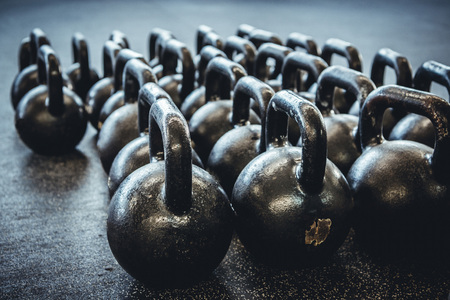 Kettlebells organized and put away at the gym. Zdjęcie Seryjne