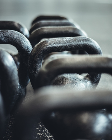 Kettlebells organized and put away at the gym. Stock Photo