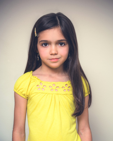 acting: Young girl with brown hair acting