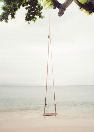 gentle dream vacation: A beach swing on a quiet beach in Thailand.
