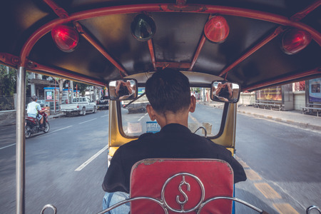 POV from the backseat of a Tuk Tuk in Bangkok, Thailand