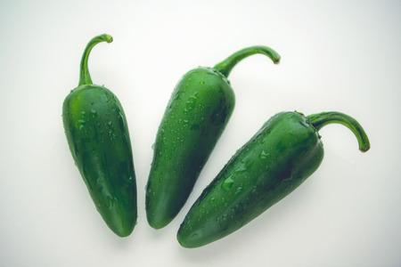 3 jalepeno peppers shot on white background Stock Photo