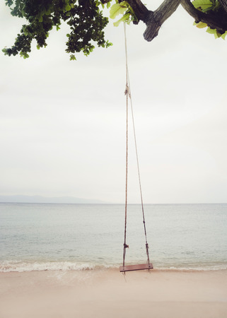 space for type: A beach swing on a quiet beach in Thailand.