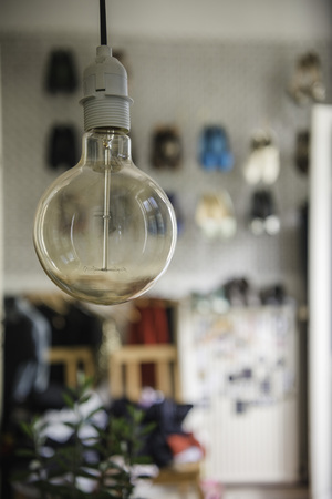 Closeup of an Edison light bulb in apartment interior