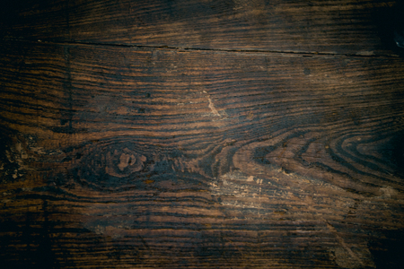 Close up of old, rustic, scratched brown wood surface.