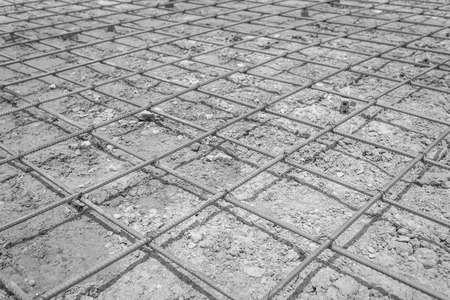 reinforced: steel mesh used to make reinforced concrete , black and white