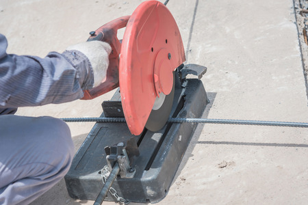 mitre: cutting a metal and steel with compound mitre saw with sharp, circular blade