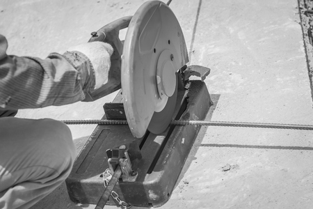 assemblies: cutting a metal and steel with compound mitre saw with sharp, circular blade , black and white Stock Photo