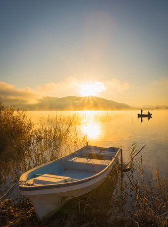 beautiful scenery: Boats on the lake Kawaguchiko, sunrise,,People fishing on a boat,silhouette