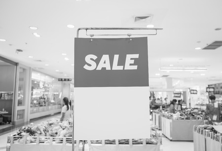 boutique display: sale sign on mall ,black and white