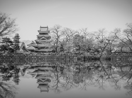 matsumoto: Matsumoto Castle is one of the most complete and beautiful among Japans original castles , reflection ,black and white Editorial