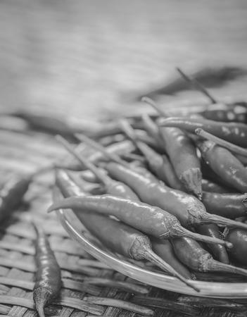 threshing: chilli on the Weave threshing basket , black and white Stock Photo