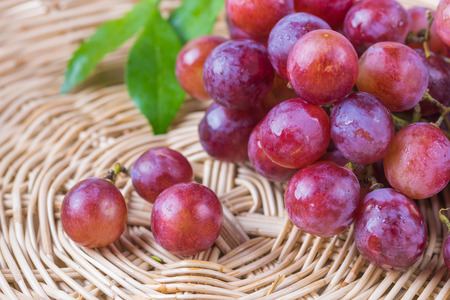 red grape: purple round grapes on  wicker baskets