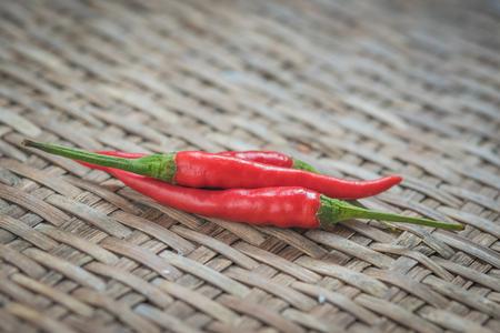 threshing: chilli on the Weave threshing basket