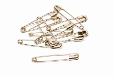 Safety pin isolated on white background Imagens