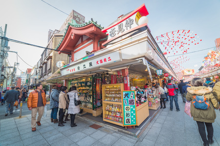 senso ji: TOKYO - January 25 2015 : Nakamise shopping street in Asakusa connect to Senso-ji Temple in Asakusa, Tokyo on 25 January 2015.The Senso-ji Temple in Asakusa is the most famous temple in tokyo Editorial