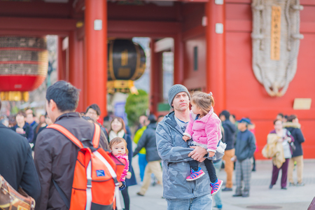 senso ji: TOKYO,JAPAN - January 25, 2015  :Unidentified tourists in the Senso-ji Temple on January 25, 2015  in Tokyo,Japan.The Senso-ji Buddhist Temple is the symbol of Asakusa and one of the most famed temples in all of Japan