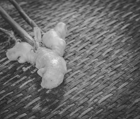 threshing: Ginger root on the Weave threshing basket , black and white