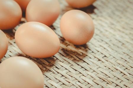 threshing: Egg on the Weave threshing basket , vintage Stock Photo
