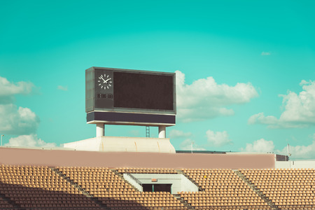 score board at football stadium with bluesky , vintage tone Stock Photo