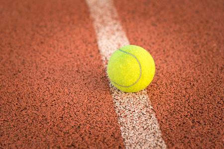 wimbledon: Close up of tennis ball on clay court.Tennis ball Stock Photo
