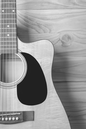 bluegrass: Acoustic guitar on wood background  , black and white. Stock Photo