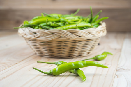 pimiento: Green peppers on wooden background