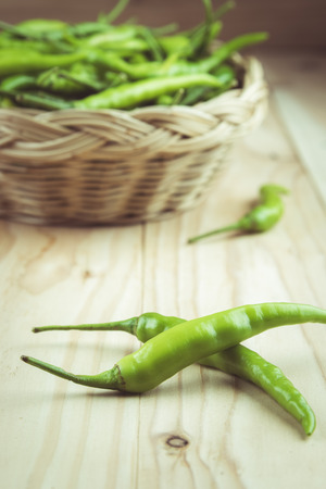 pimiento: Green peppers on wooden background , vintage tone