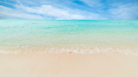 Wave of the sea on the sand beach. Stock Photo