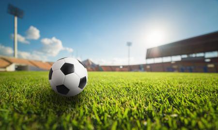 Soccer ball on the grass in soccer stadium