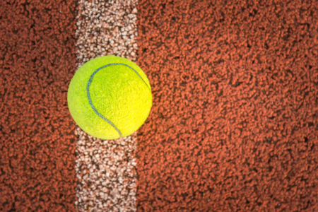 Close up of tennis ball on clay court.Tennis ball Stock Photo