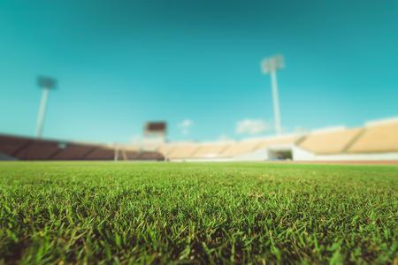 Green grass in soccer stadium , vintage tone