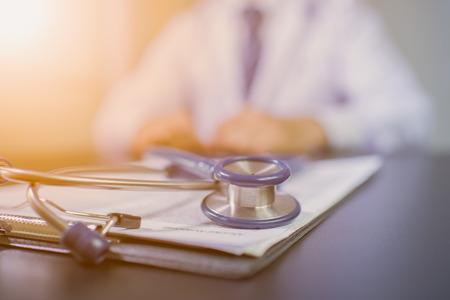 Medicine doctor's working table. Focus on stethoscope 写真素材