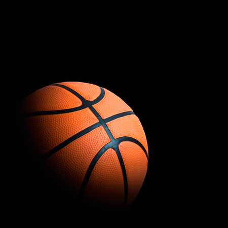 basketball association basket ball against black background good advertising concept with space for text Stock Photo