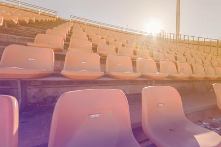Empty seats at soccer stadium , vintage tone