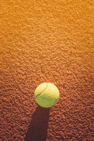 Close up of tennis ball on clay court.Tennis ball ,  vintage tone