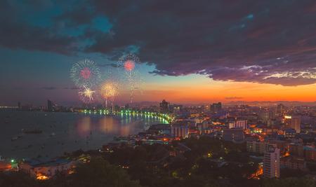 Multicolor fireworks night scene, blurred photo pattaya cityscape sea beach view, thailand. vintage