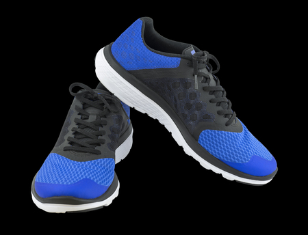 Pair of blue sport shoes on black background. Sport shoes isolated. File contains a clipping path. Stock Photo