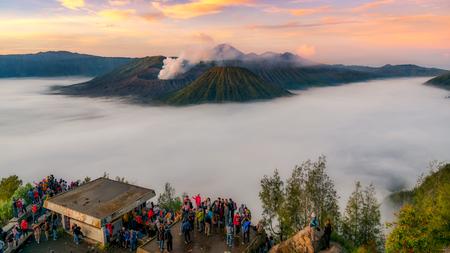 Trekker taking photo of Gunung Bromo volcano in Java, Indonesia, Sunrise Stock Photo