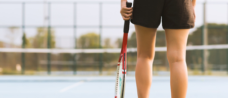 Tennis player holding racket preparing for playing game on outdoor court during summer. vintage tone banner panoramic crop for copy space. Stock Photo