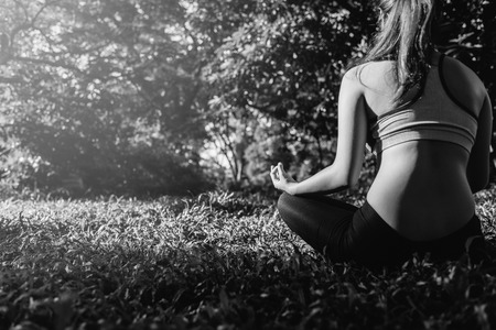 Yoga in the park, outdoor with effect light, health woman, Yoga woman. Concept of healthy lifestyle and relaxation. black and white.