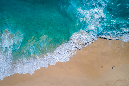 Aerial view to tropical sandy beach and blue ocean wave in Indonesia Stock Photo