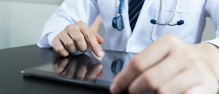 Doctors working in hospitals. hand holding using tablet. banner panoramic crop for copy space. Stock Photo