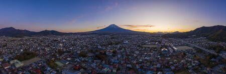 Aerial view panorama of mount Fuji in city at Fujiyoshida, Yamanashi, Japan. Fujisan on sanset.