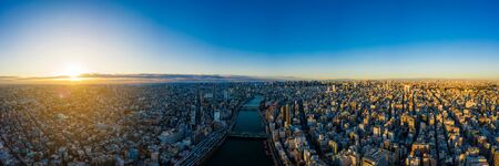 Aerial panorama view by drone of Tokyo Cityscape on sunrise in Tokyo, Japan. Panoramic view of buildings in Tokyo city