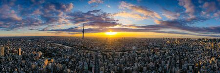 Aerial panorama view by drone of Tokyo Cityscape with Tokyo Sky Tree visible in Tokyo city, Japan on sunrise.