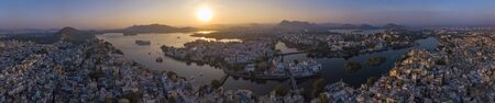 Aerial view of Udaipur City Palace In The sunset Panorama View. Udaipur, India