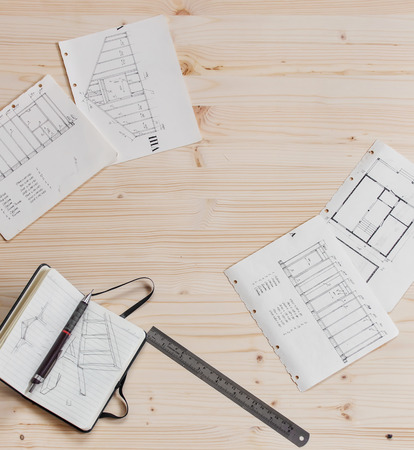 subflooring: frame house design and sketches on wood