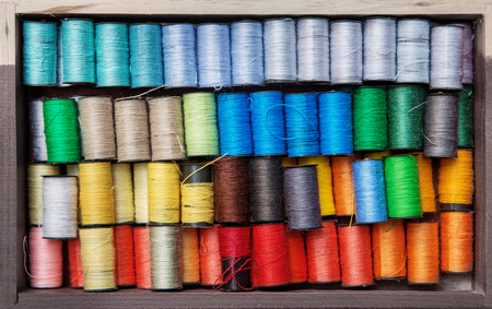 needlewoman: wooden box with  colorful threads for needlewoman Stock Photo